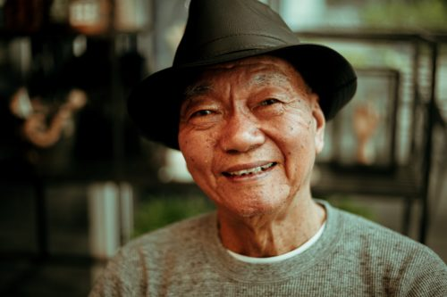 photo of old asian gentleman smiling