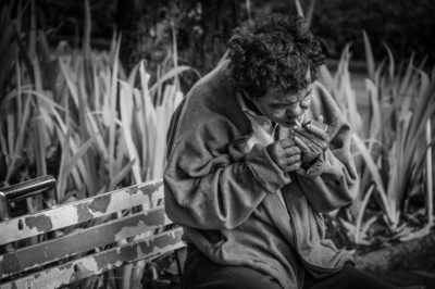 photo of homeless man smoking